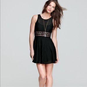 free people | black daisy lace mini dress